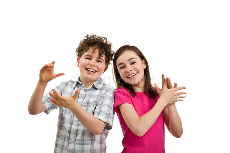 Kids clapping royalty free stock images