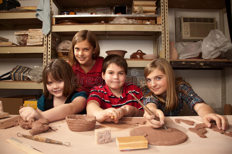 Kids in a clay studio royalty free stock image