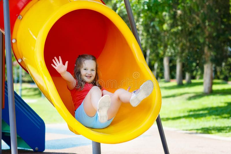 Kids on playground. Children play in summer park. royalty free stock photography
