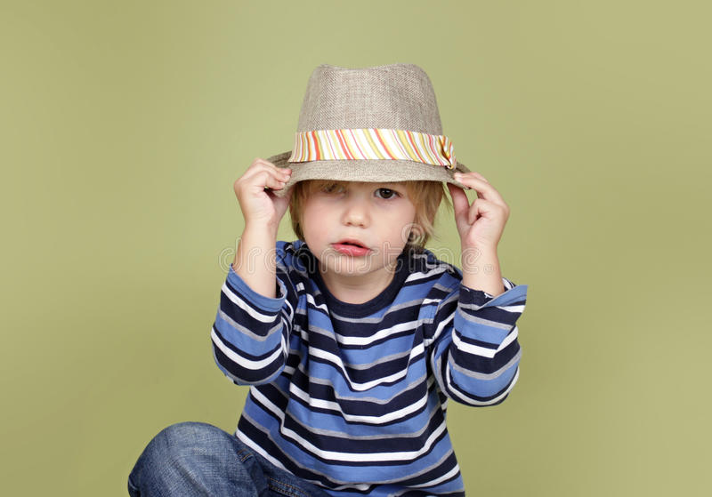 Kids Clothing and Fashion. Kids, children clothing and fashion. Happy boy with a fedora hat, posing and having fun stock photography