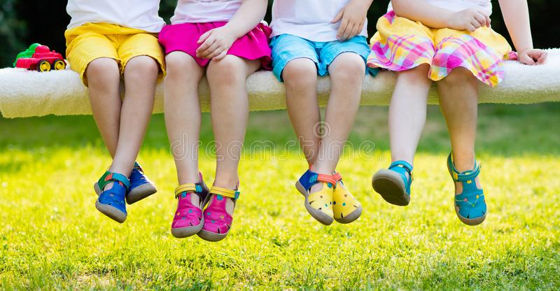 Kids with colorful shoes. Children footwear. Footwear for children. Group of preschool kids wearing colorful leather shoes. Sandal summer shoe for young child royalty free stock image