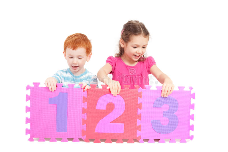 Download Kids Counting 123 With Number Tiles Stock Photo - Image of friends, coloured: 18414104