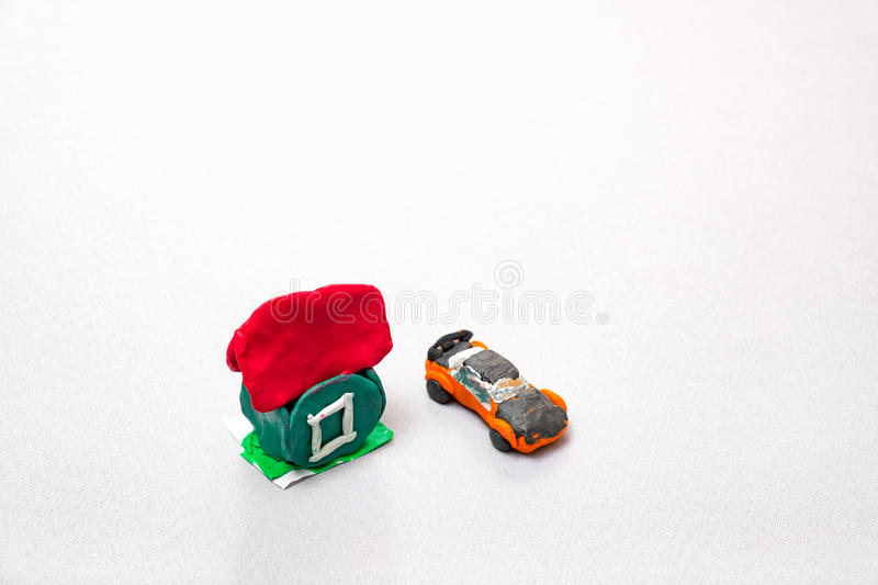 Kids crafts house and car of clay royalty free stock images