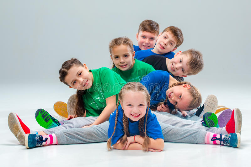 The kids dance school, ballet, hiphop, street, funky and modern dancers. On gray studio background stock photo