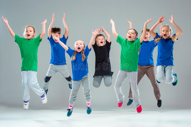 The kids dance school, ballet, hiphop, street, funky and modern dancers. On gray studio background stock photography