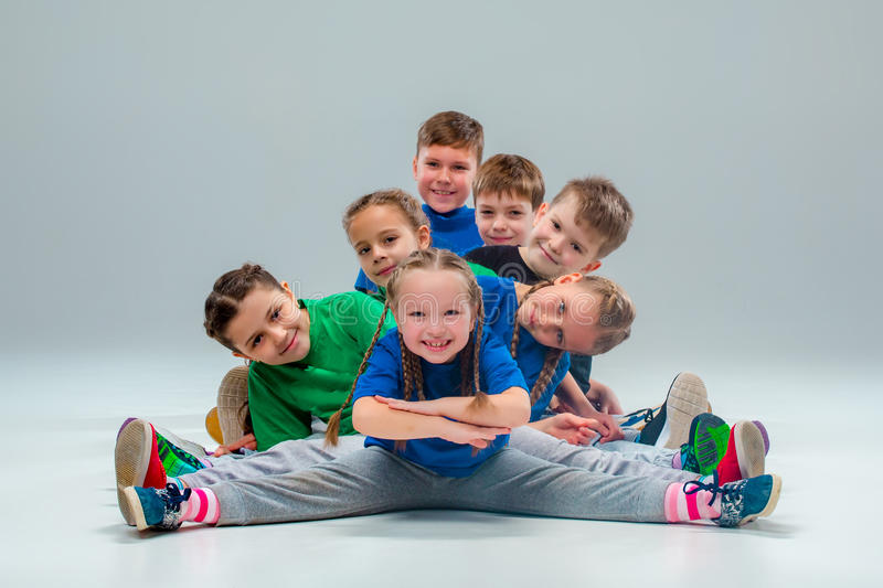 The kids dance school, ballet, hiphop, street, funky and modern dancers. On gray studio background royalty free stock image