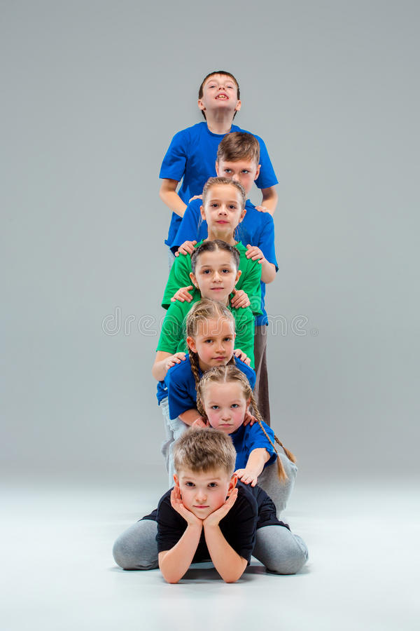 The kids dance school, ballet, hiphop, street, funky and modern dancers. On gray studio background royalty free stock photos