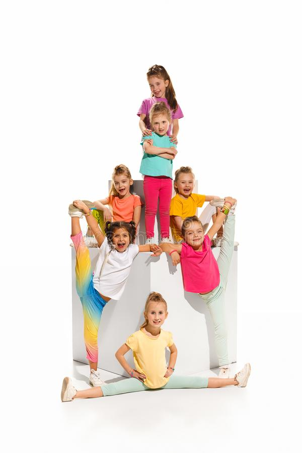The kids dance school, ballet, hiphop, street, funky and modern dancers. On white studio background. Girl is showing aerobic and dance element. Teen in hip hop stock images
