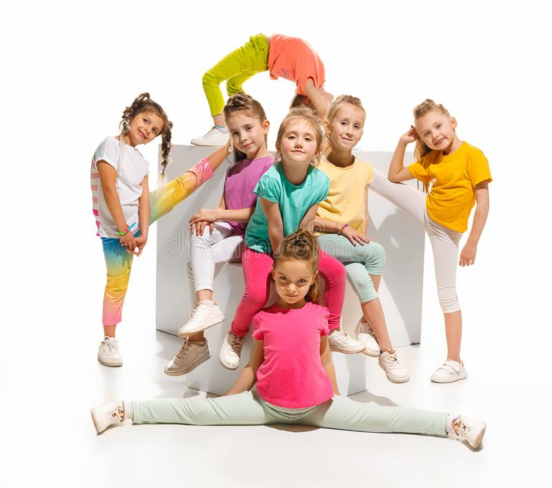 The kids dance school, ballet, hiphop, street, funky and modern dancers. On white studio background. Girl is showing aerobic and dance element. Teen in hip hop stock photos
