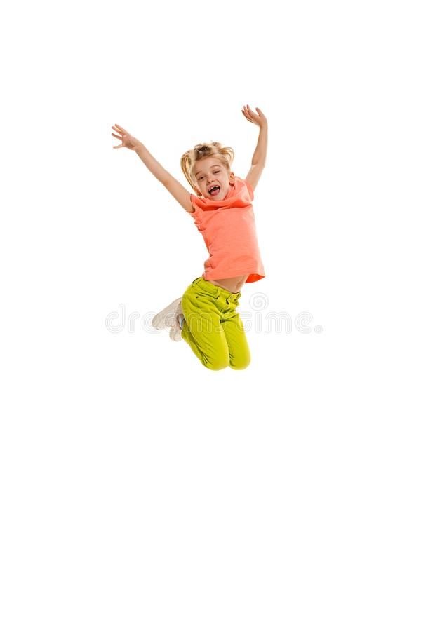 The kids dance school, ballet, hiphop, street, funky and modern dancers. On white studio background. Happy girl is showing aerobic and dance element. Teen in stock images