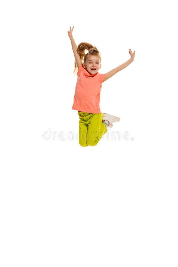 The kids dance school, ballet, hiphop, street, funky and modern dancers. On white studio background. Happy girl is showing aerobic and dance element. Teen in royalty free stock image