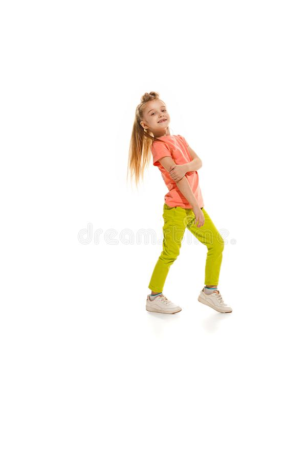 The kids dance school, ballet, hiphop, street, funky and modern dancers. On white studio background. Happy girl is showing aerobic and dance element. Teen in royalty free stock photo