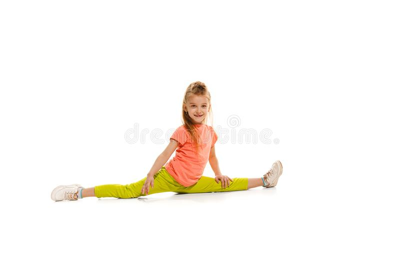 The kids dance school, ballet, hiphop, street, funky and modern dancers. On white studio background. Happy girl is showing aerobic and dance element. Teen in stock photos