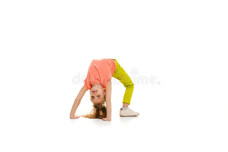 The kids dance school, ballet, hiphop, street, funky and modern dancers. On white studio background. Happy girl is showing aerobic and dance element. Teen in royalty free stock images