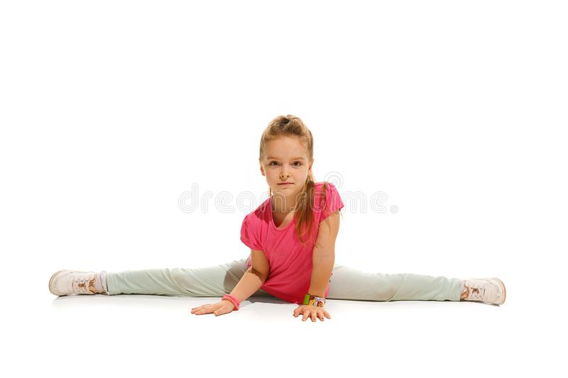 The kids dance school, ballet, hiphop, street, funky and modern dancers. On white studio background. Happy girl is showing aerobic and dance element. Teen in stock photography