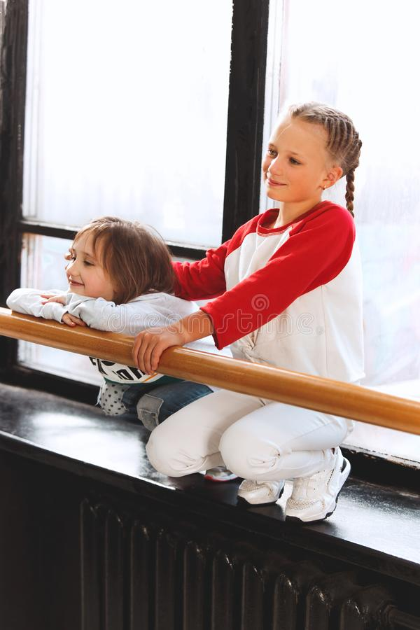 The kids at dance school. Ballet, hiphop, street, funky and modern dancers. The kids sitting at dance school. Ballet, hiphop, street, funky and modern dancers stock images