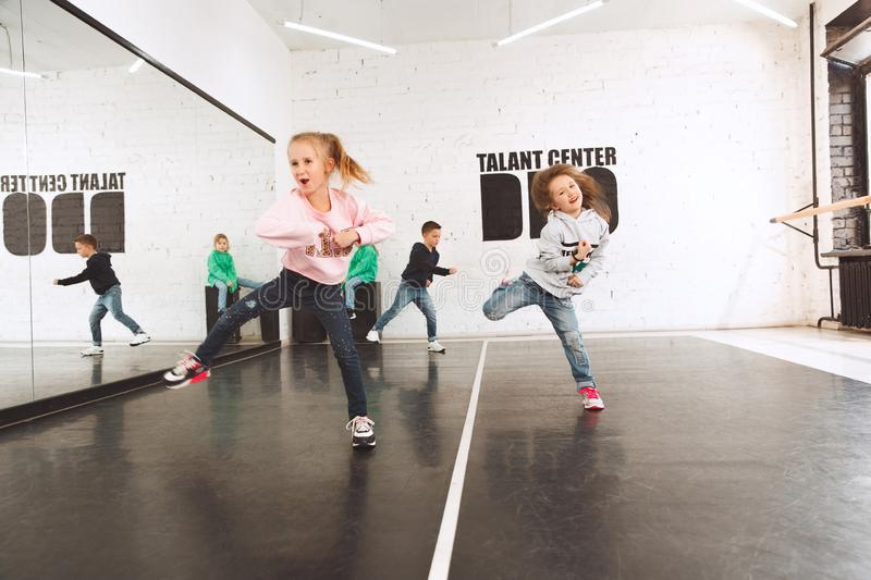 The kids at dance school. Ballet, hiphop, street, funky and modern dancers. The kids sitting at dance school. Ballet, hiphop, street, funky and modern dancers stock image
