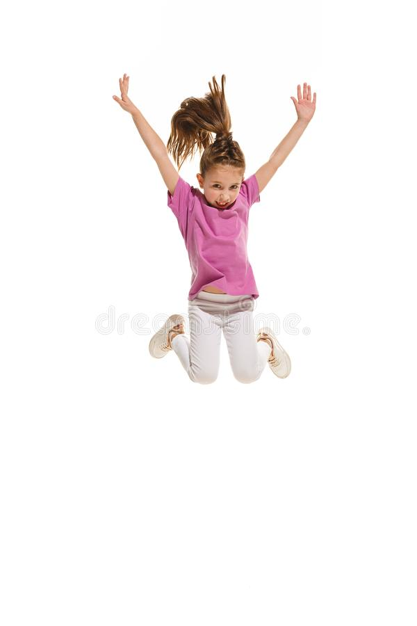 The kids dance school, ballet, hiphop, street, funky and modern dancers. On white studio background. Happy girl is showing aerobic and dance element. Teen in stock photo