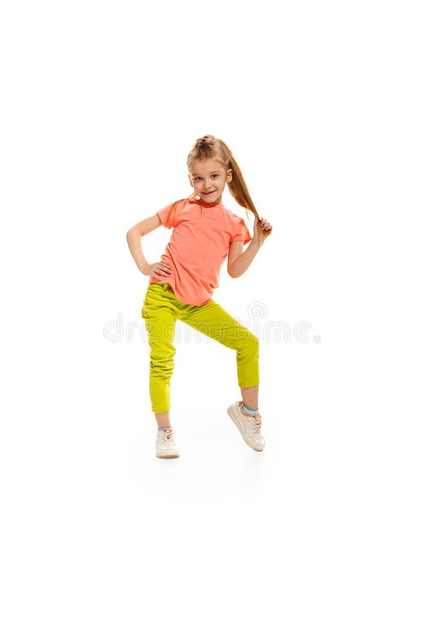 The kids dance school, ballet, hiphop, street, funky and modern dancers. On white studio background. Happy girl is showing aerobic and dance element. Teen in royalty free stock photography