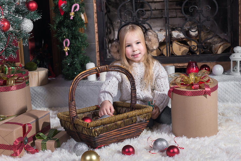 Kids decorate Christmas tree. Happy little kids decorate Christmas tree in beautiful living room with traditional fire place. Children opening presents on Xmas royalty free stock photo