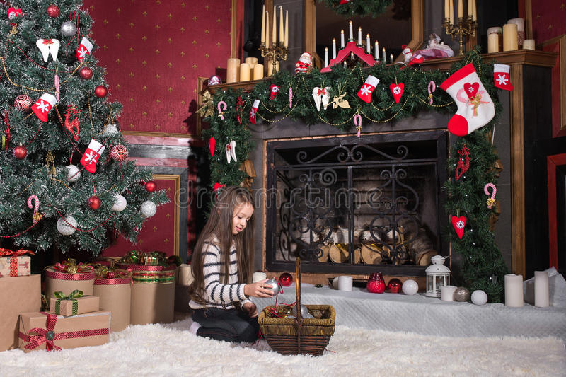 Kids decorate Christmas tree. Happy little kids decorate Christmas tree in beautiful living room with traditional fire place. Children opening presents on Xmas stock photos