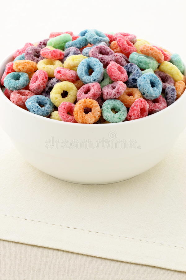 Kids delicious cereal loops or fruit cereal stock photography