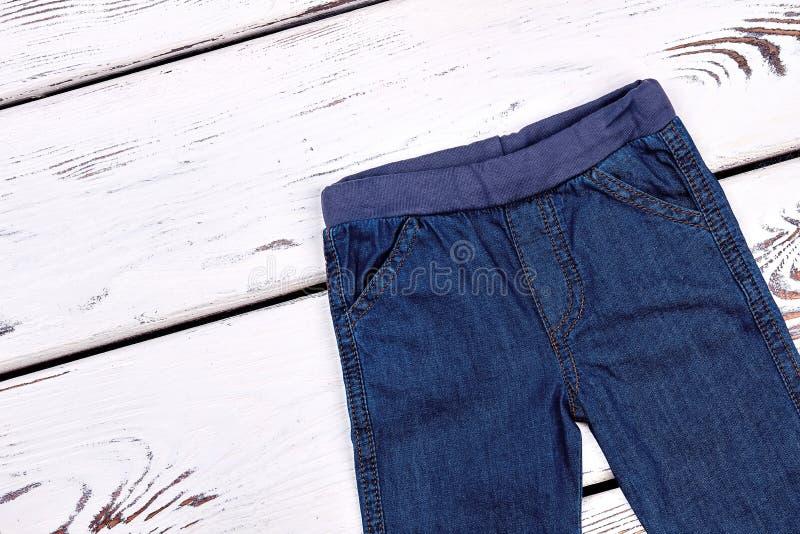 Kids denim pants, top view. royalty free stock images