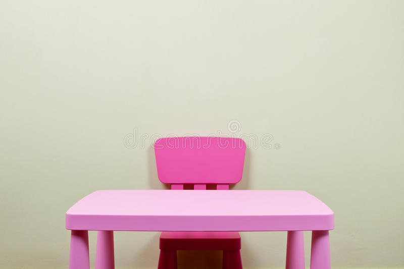 kids desk and chair against the wall stock photo image 23080940. Black Bedroom Furniture Sets. Home Design Ideas