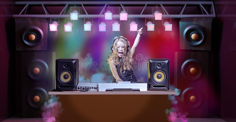 Kids disco with DJ Babe. A gradeschooler girl as DJ at the kids disco stock image