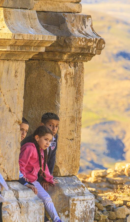 Kids in Djemila. Children visiting the Roman ruin in the Djemila city in Sétif county, Algeria royalty free stock photography