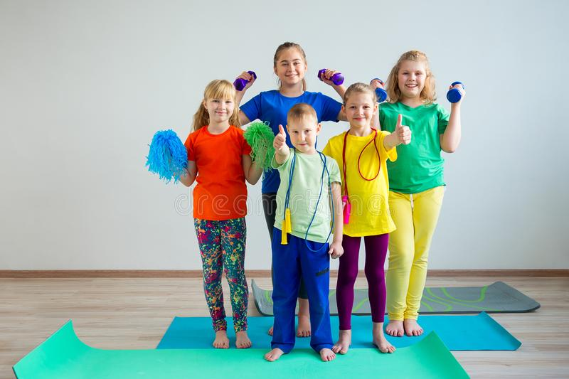 Kids doing exercises stock photography