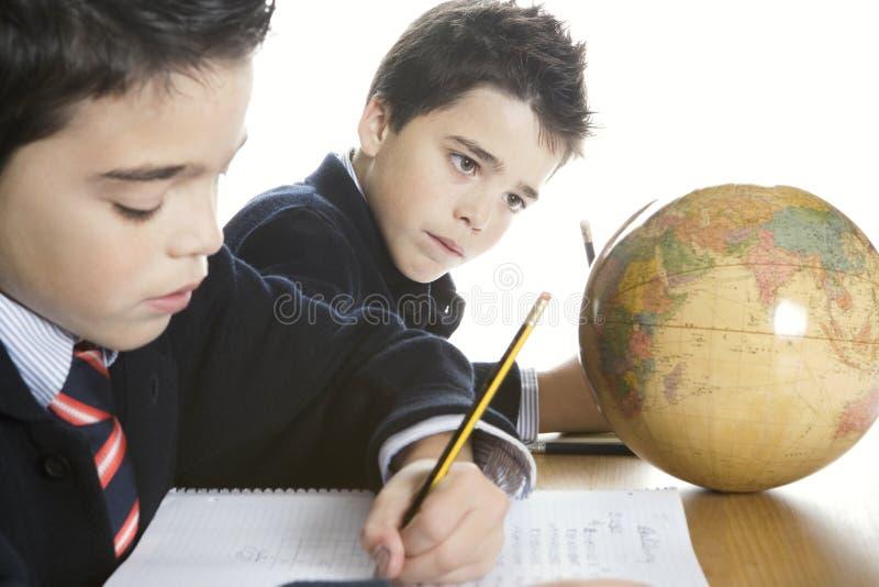 Kids doing homework at home stock photo