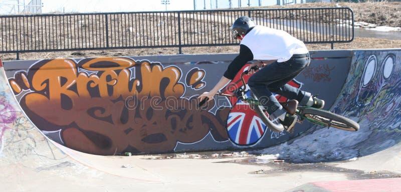 Kids doing stunts at bike park royalty free stock photos