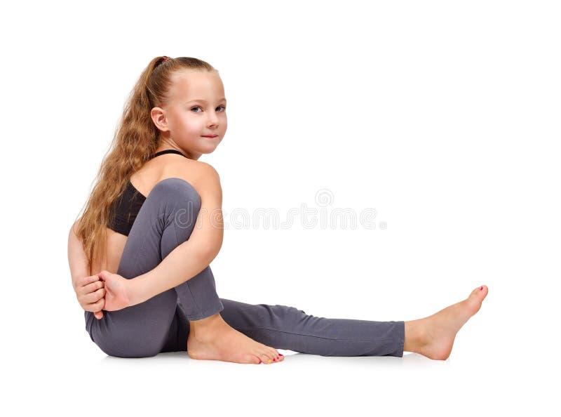 Kids doing yoga exercises. On a white background royalty free stock image