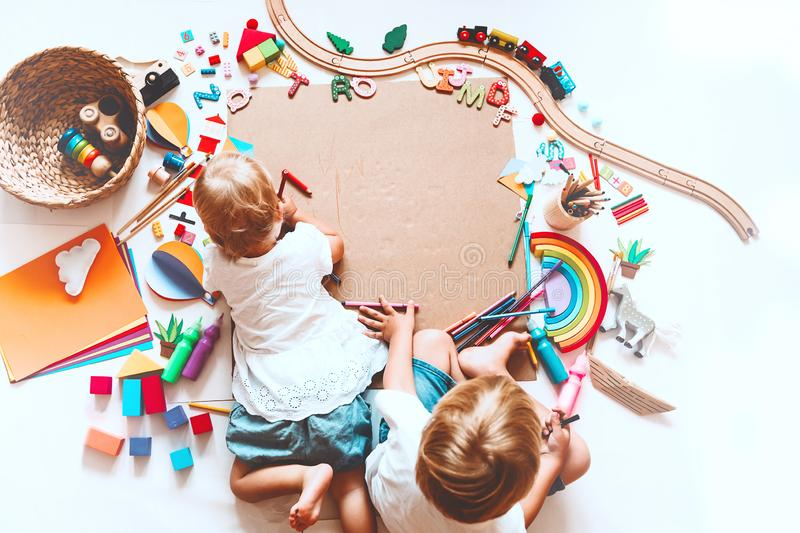 Kids draw and make crafts. Kindergarten or preschool background. Kids draw and make crafts. Children with educational toys and school supplies for creativity royalty free stock image