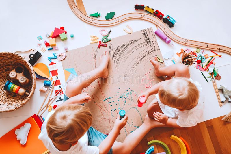 Kids draw and make crafts. Kindergarten or preschool background. Kids draw and make crafts. Children with educational toys and school supplies for creativity royalty free stock photo