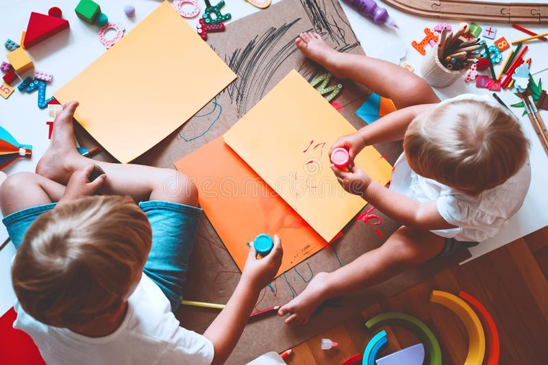 Kids draw and make crafts. Kindergarten or preschool background. Kids draw and make crafts. Children with educational toys and school supplies for creativity stock image