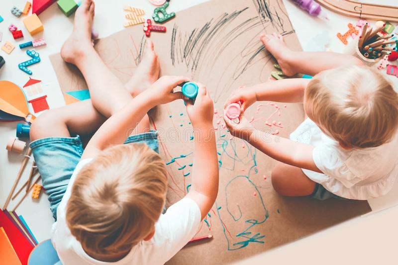 Kids draw and make crafts. Kindergarten or preschool background. Kids draw and make crafts. Children with educational toys and school supplies for creativity royalty free stock photos