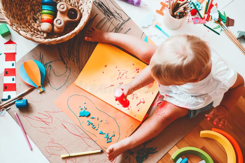 Kids draw and make crafts. Kindergarten or preschool background. Kids draw and make crafts. Children with educational toys and school supplies for creativity royalty free stock photography