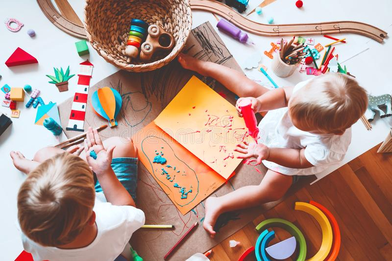 Kids draw and make crafts. Kindergarten or preschool background. Kids draw and make crafts. Children with educational toys and school supplies for creativity royalty free stock images