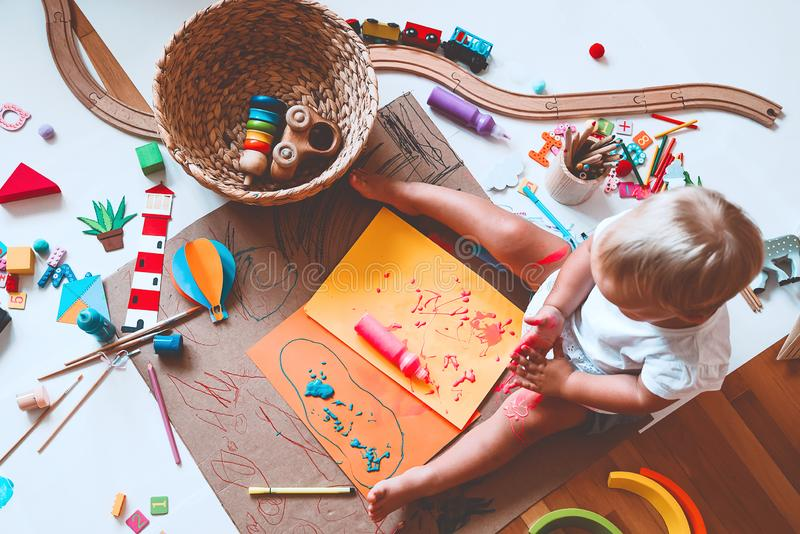 Kids draw and make crafts. Kindergarten or preschool background. Kids draw and make crafts. Children with educational toys and school supplies for creativity stock photos