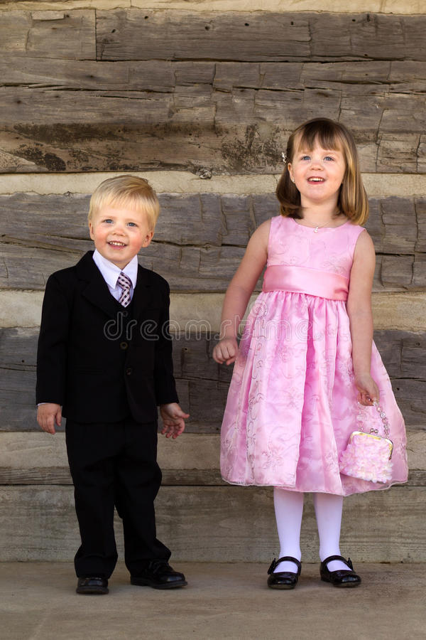 Kids dressed in fancy formal clothes stock photography