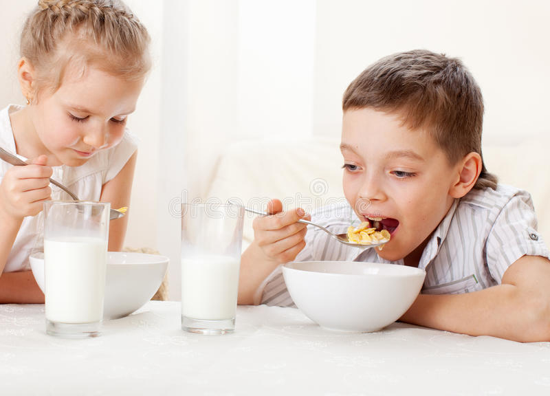 Kids eat breakfast stock photo. Image of drink, pitcher ...