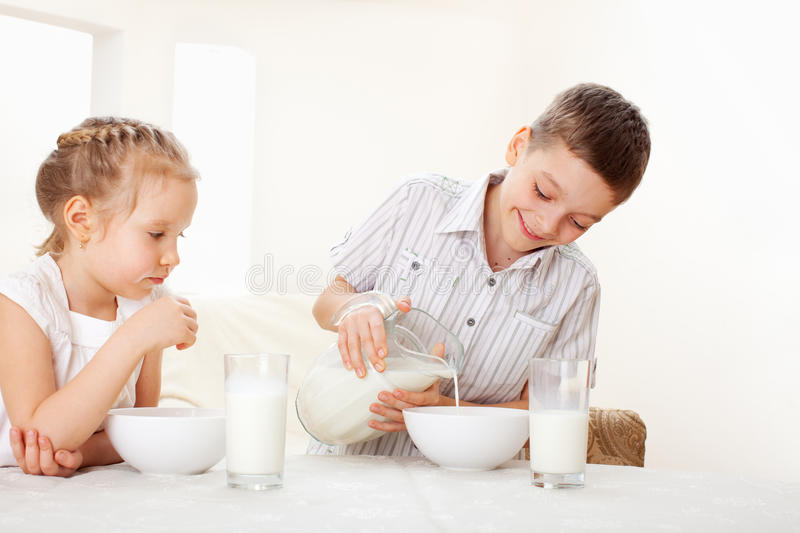 Kids eat breakfast stock image. Image of children, home ...
