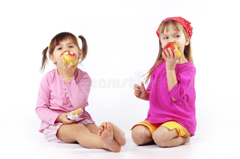 Kids eating apples stock photo
