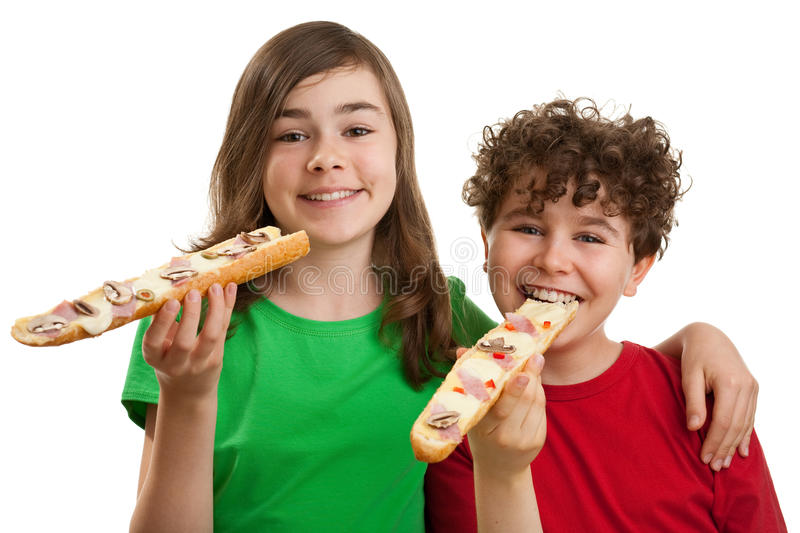 Kids eating big sandwich. Young girl and boy eating healthy sandwich isolated on white background stock photo