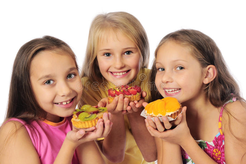 Kids eating cakes stock photo