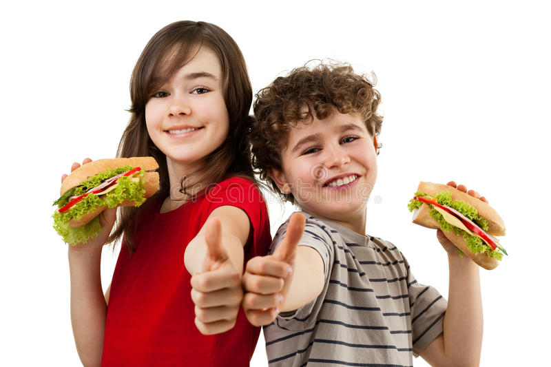 Kids eating healthy sandwiches royalty free stock photos