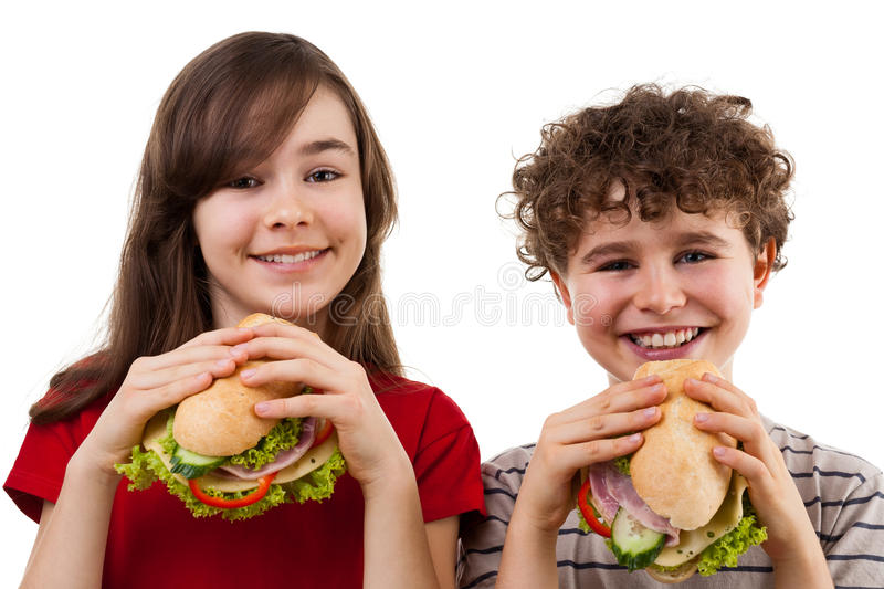 Kids eating healthy sandwiches stock photography