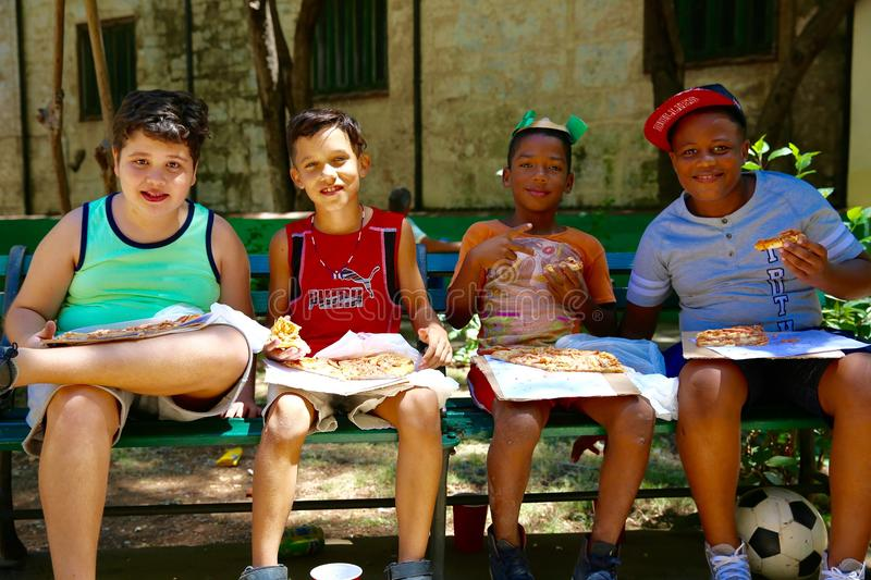 Kids Eating Pizza, Cuba royalty free stock images